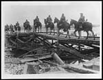 X.33042Cavalry passing over a temporary bridge built by our troops to replace the bridge destroyed by the Germans