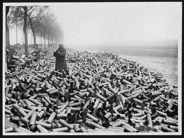 (6) N.381 - Some shell cases on the roadside in the front area, the contents of which have been despatched over into the German lines