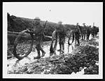 C.1050Wiring parties going up to the front line after heavy rain